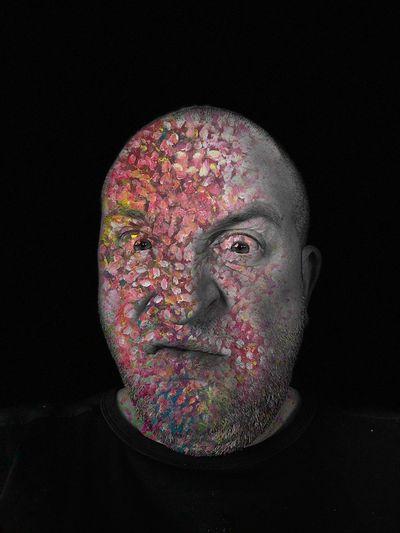 Digital composite image of multi colored face against black background