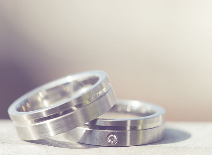 Close-Up Of Wedding Rings On Table