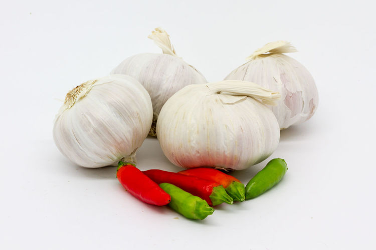 Garlic and chilli Arrangement Chillis Choice Close-up Cooking Food Freshness Garlic Garlic Bulbs Green Color Group Of Objects Healthy Eating Multi Colored No People Organic Raw Food Spices Still Life Studio Shot White Background Whole