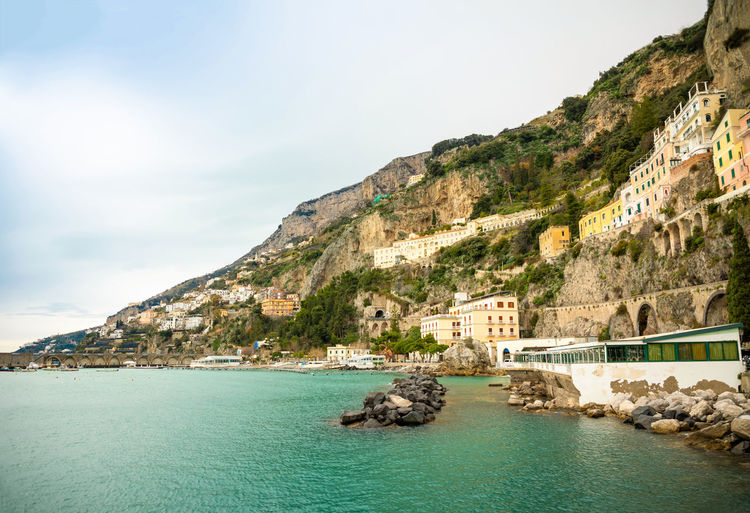 Italy Amalfi  Amalfi Coast Water Sea Mountain Sky Nature Scenics - Nature Beauty In Nature Day Building Exterior Built Structure Architecture Land No People Waterfront Building Tranquility Tranquil Scene Rock Outdoors Formation Turquoise Colored