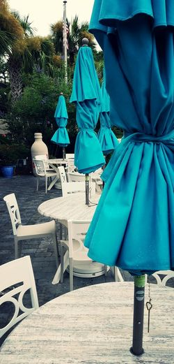 Turquoise Blue Aqua Raindrops Rain Umbrellas Umbrella Tied Closed Umbrella Marble Coligny Colignyplaza Hilton Head Hilton Head Island, SC Hilton Head Island SC Beach Tables And Chairs Table Chair Tables Chairs Outdoors Gathering Red Stripe Beer
