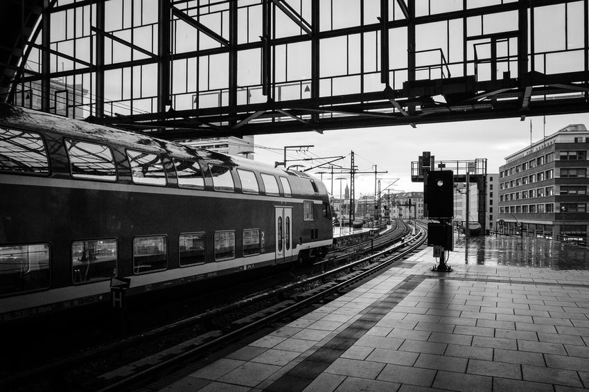 Architecture Arrival Blackandwhite Building Exterior Built Structure City Day Incidental People Mode Of Transportation One Person Outdoors Platform Public Transportation Rail Transportation Railroad Station Railroad Station Platform Railroad Track Real People Station Track Train Train - Vehicle Transportation Travel