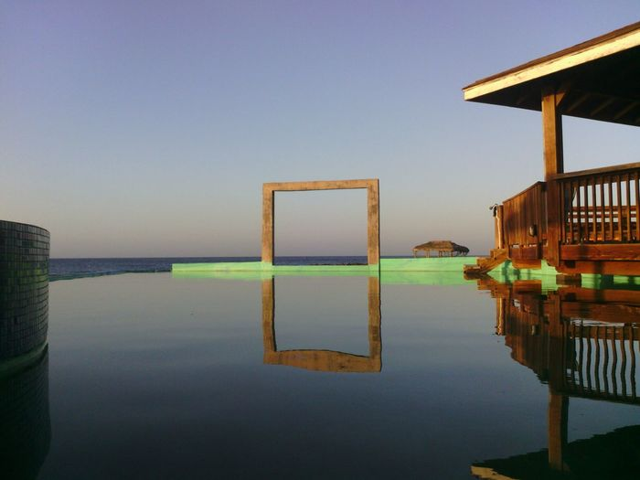 Rare view of infinity pool against calm sea