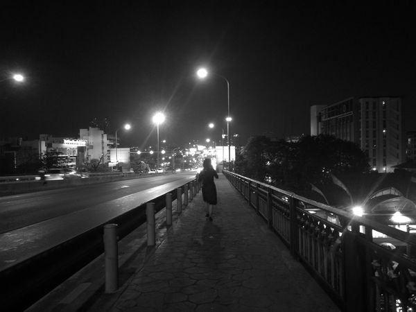 Night Street Light One Person Full Length Railing Illuminated City Rear View Sky People Real People Outdoors Men Adults Only Bridge - Man Made Structure Adult Architecture