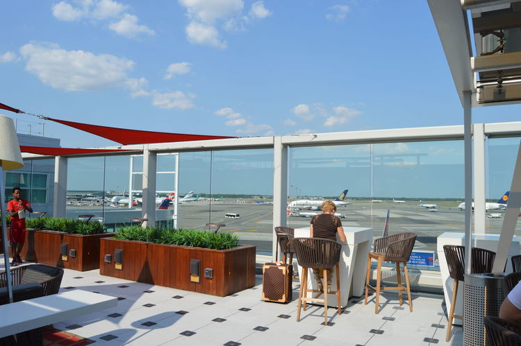 Adult Airport Balcony Chair Delta Airlines Leisure Activity Lifestyles Lounge Luxury Men New York People Relaxation Senior Adult Senior Men Sitting Sky Sunlight Swimming Pool Table Vacations View Wealth Weekend Activities