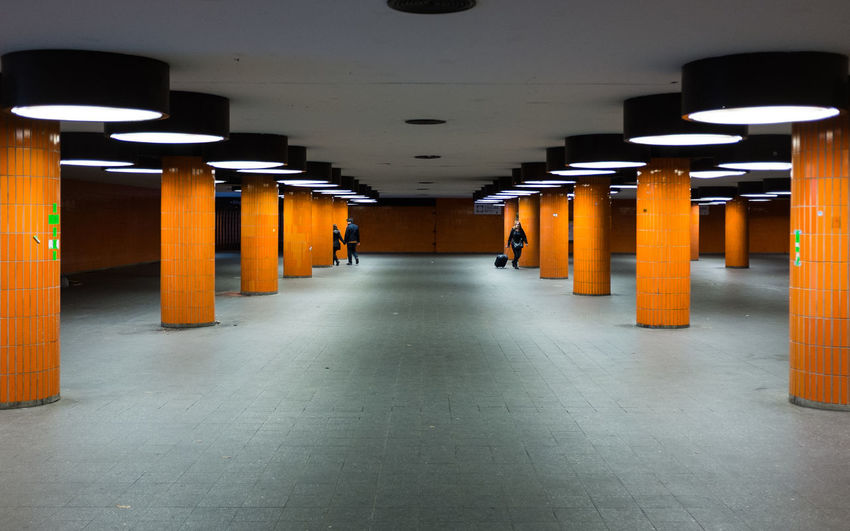 one of the most instagramesque places in berlin Allhailsymmetry Architectural Column Architecture Berlin Built Structure Ceiling Ceiling Light  Column Empty Hungergames Illuminated In A Row Indoors  Interior Light Lit Messe Berlin Messe ICC Orange Subway Symmetrical Symmetry The Way Forward Underground Underpass