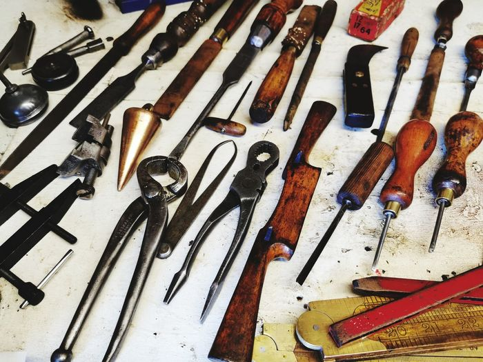 High angle view of tools on wood