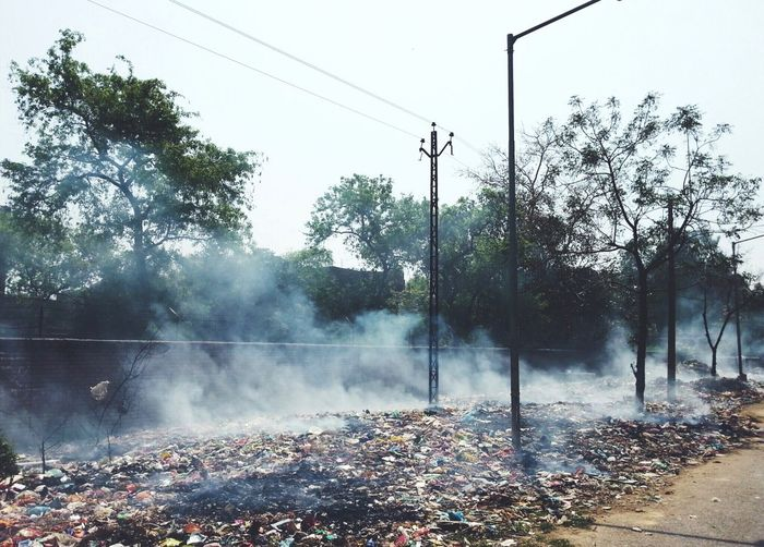 Scenic view of burning trash on street