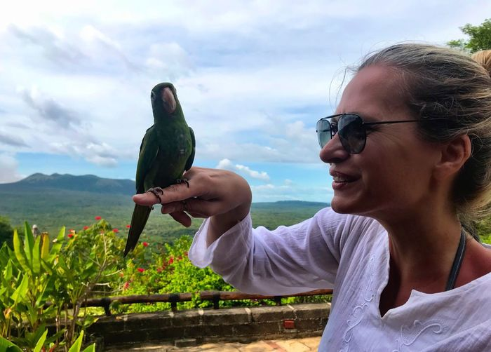 Real People One Person Sky Outdoors Lifestyles Smiling Headshot Happiness One Animal Eyeglasses  Parrot Parrot Lover Bird Bird Photography Bonding Togetherness Nature Nicaragua Centralamerica