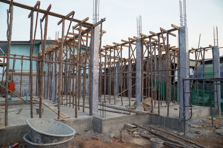 Construction Pillar Steel Reinforced Site Concrete Building Structure Industrial Home Metal Industry Foundation Cement Outdoor Material Iron Builder Construct Infrastructure Work House Ground Rod Rebar Pole Bar Reinforcement Engineering Rusty Job Dirty Pillars Bars Architecture Close-up Equipment Gray Rough