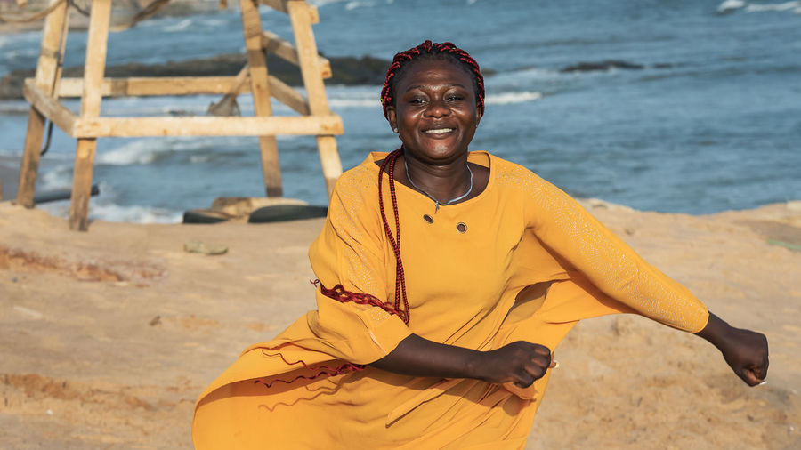 Happy africa ghana woman on the beach in accra