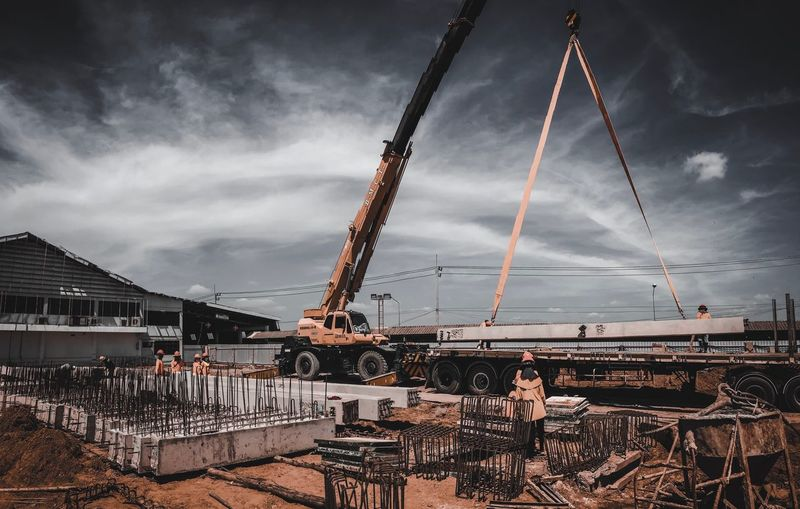 Low angle view of abandoned construction site against sky