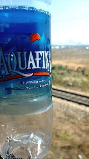 Purity Guaranteed! Train Journey Aquafina Water Aqua Farms Traintracks Morning