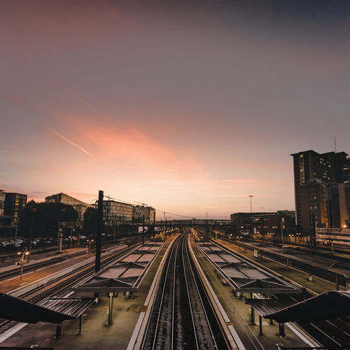 High angle view of railroad tracks at sunset