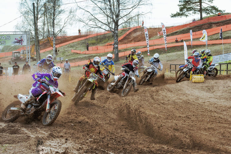 "APE, LATVIA - MAY 14, 2017: Motocross competition ""Vaidava Cup 2017"" Adult Adventure Clouds Competition Crash Helmet Day Extreme Sports Headwear Helmet Latvia Men Motion Motocross Motorcycle Outdoors People Real People Riding RISK Speed Sport Sports Helmet Sports Racing Transportation Vaidava"
