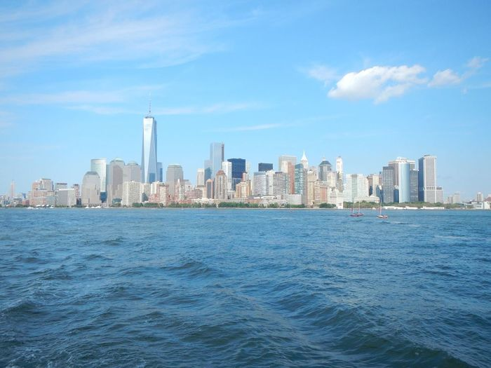 #nyc #wtc #worldtradecenter #trip #memories Architecture Building Exterior Built Structure City Cityscape Cloud - Sky Day Downtown District Nature No People Outdoors Sea Sky Skyscraper Tower Urban Skyline Water Waterfront