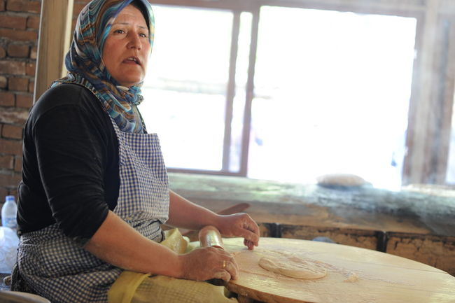 Turkish woman making lavash in traditional place Bread Culture Day Eat Food Indoors  Lavash Making Muslim Woman Real People Restaurant Traditional Turkish Woman Woman Working Work