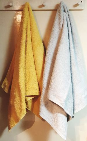 Two shower towels hanging in a white door Indoor Indoors  No People Still Life Textile Close-up Clothing Towel High Angle View Variation Group Of Objects Clean Hanging Large Group Of Objects Multi Colored Choice Day Pattern Hygiene Brown Home Interior