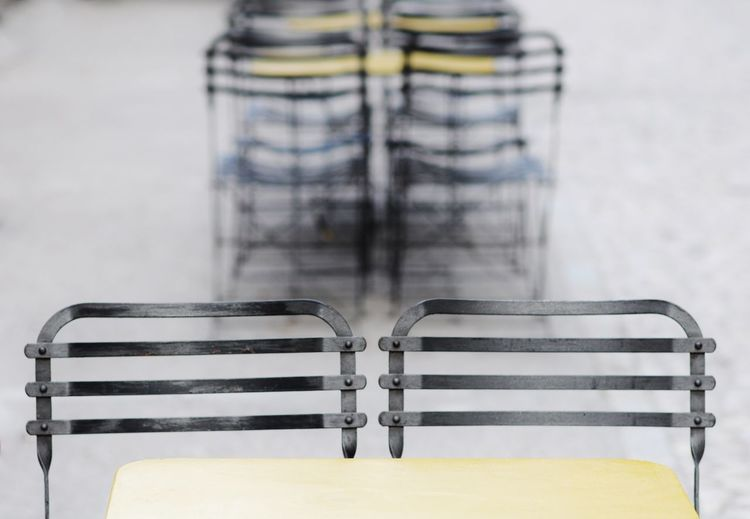 Close-Up Of Chairs And Table