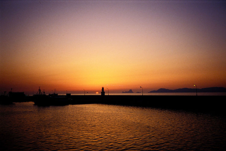 Sunset Water Sky Nautical Vessel Transportation Silhouette Sea Waterfront Orange Color Beauty In Nature Mode Of Transportation Scenics - Nature Tranquil Scene Tranquility Nature Idyllic Outdoors Copy Space No People Sailboat