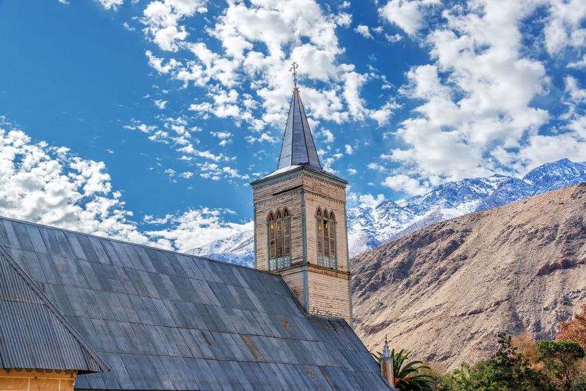 Church with Andes mountains in the background in Pisco Elqui in the Elqui Valley in Chile America Andes Architecture Building Buildings Cathedral Catholicism Chile Church City Downtown Elqui Exterior Famous Landmark Latin Mountains Old Pisco Religion South Town Travel White Worship