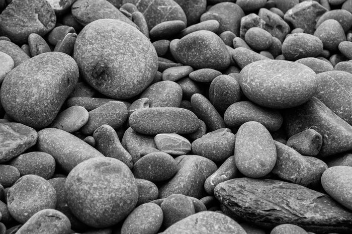 Collection of sea-worn pebbles on a beach Abstract Backgrounds Beach Blackandwhite Close-up Day Eroded Full Frame Greyscale Large Group Of Objects Macro Monochrome Nature No People Pebble Pebble Beach Rounded Stones Science Seashore Seaside Stones Stones And Pebbles Textured  Textures And Surfaces