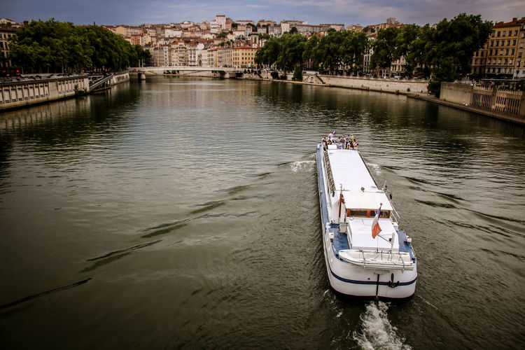City Saône River Wave Architecture Bridge Building Exterior Built Structure Connection Croix Rousse Day High Angle View Incidental People Mode Of Transportation Nature Nautical Vessel Outdoors Passenger Craft River Stormy Sky Transportation Travel Tree Water Waterfront