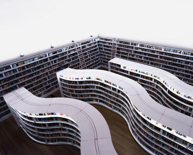 High angle view of book shelves in library