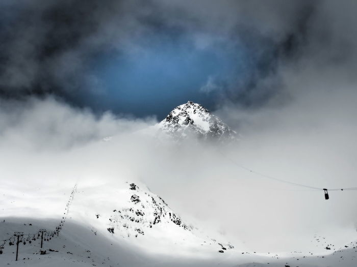 Snowcapped Mountain Covered With Cloudscape