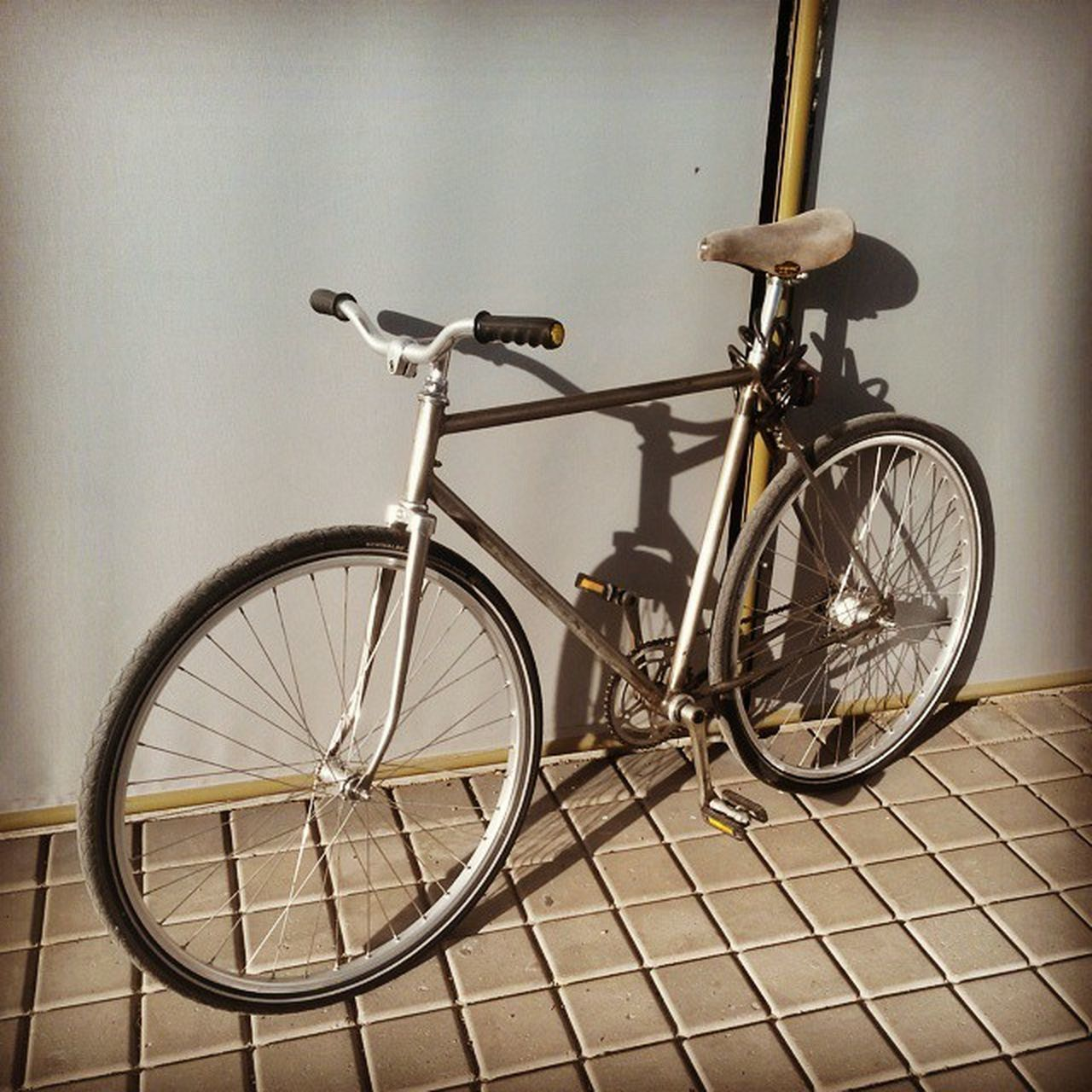 bicycle, transportation, mode of transport, land vehicle, stationary, no people, wheel, day, outdoors, bicycle rack, tire, close-up