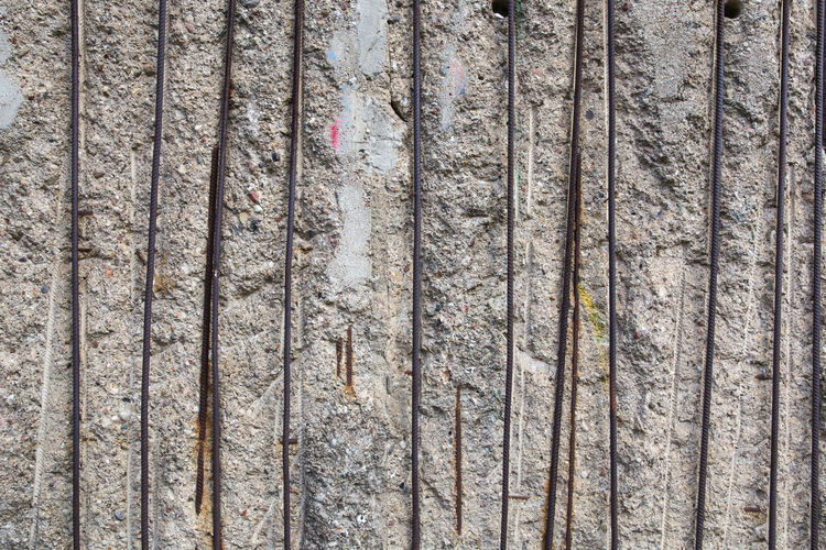 Close-Up Of Metal Rod On Weathered Wall