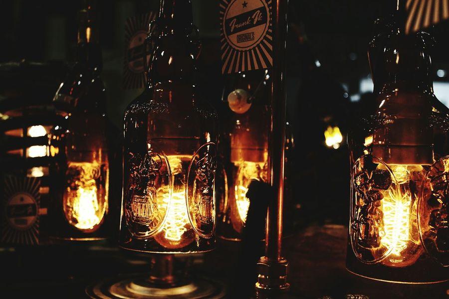 Alcune lampade di Vetro Riciclato presenti alla Fieradellartigianato a Milano. Made by Frank Originals. Lamp Illuminated Drink Lighting Equipment Close-up Crystal Glassware Real People Artisan