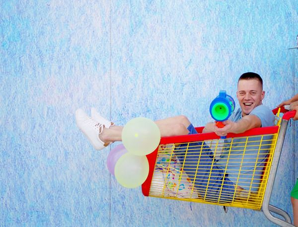 Boy playing with his toy water gun Colors Fun Happy Man Sunlight Boy Childhood Game Lifestyles Playing Summer Toy Water Gun
