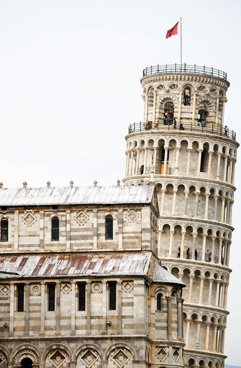 Low Angle View Of Leaning Tower Of Pisa Against Clear Sky