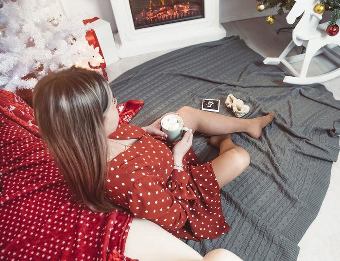 High angle view of woman lying at home