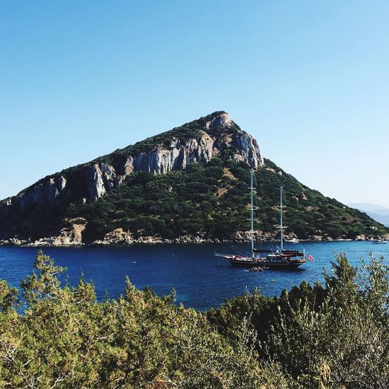 Nautical Vessel Transportation Clear Sky Water Mountain Boat Mode Of Transport Blue Tree Nature Sea Tranquil Scene Beauty In Nature Day Scenics Tranquility Non-urban Scene Outdoors Harbor No People Sardegna