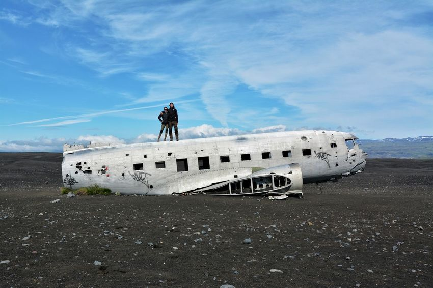 Foggy Landscape People Young Women Travel Warm Clothing Iceland Adventure Real People Connection Airplane Wreckage Antique Bomber Blacksandbeach Beach Abandoned Derelict War Blue Sky Young Adult EyeEm Selects The Week On EyeEm