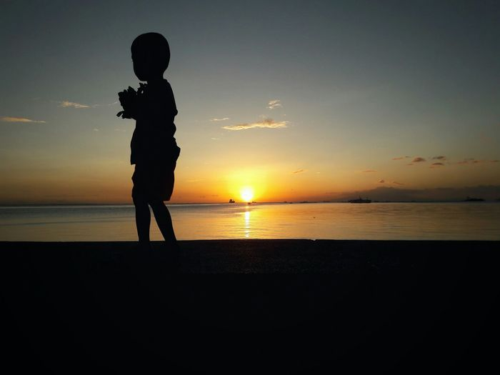 Little Boy Child One Boy Only Silhouette Sunset Horizon Over Water Childhood One Person Sunset Sky Urban Street Photography Sun Eyeem Philippines My Year My View Beginnings Finding New Frontiers The City Light Welcome To Black EyeEm Diversity Break The Mold