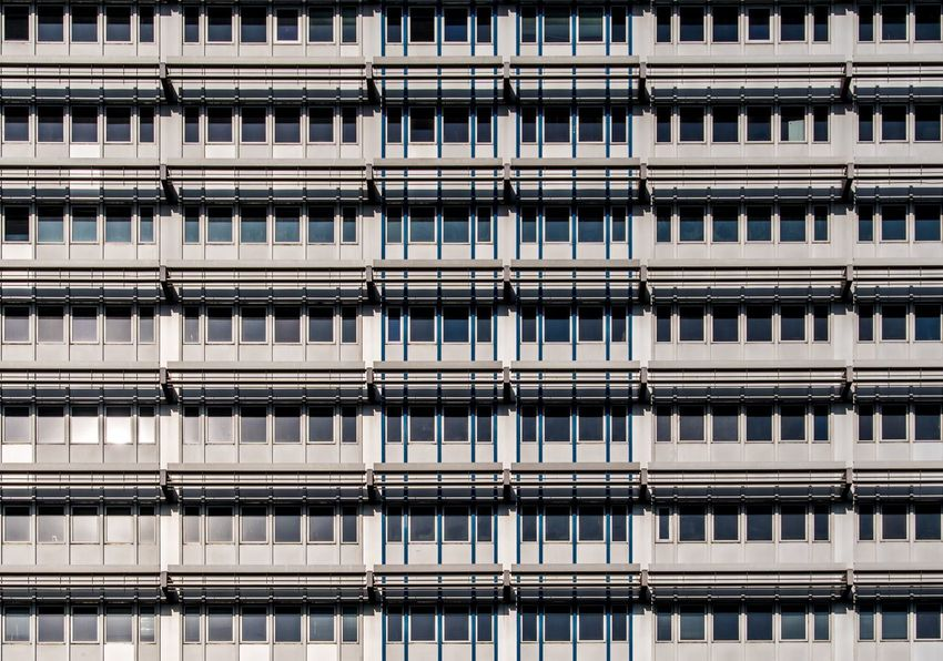 Windows Krull&Krull Images Symmetry Architecture Building Exterior Built Structure Full Frame Building Backgrounds Window Repetition No People City Residential District Pattern Apartment In A Row Outdoors Office Building Exterior Low Angle View Construction Industry Side By Side