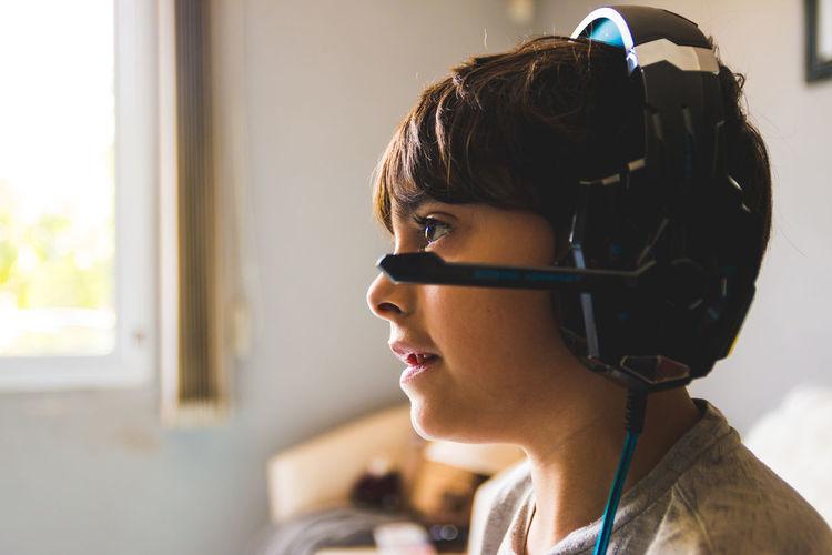 Side view of boy wearing headphones