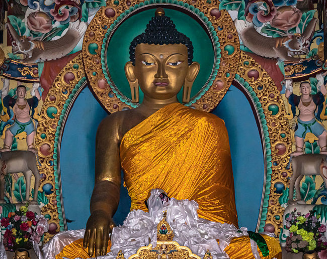 Statue of buddha in temple building
