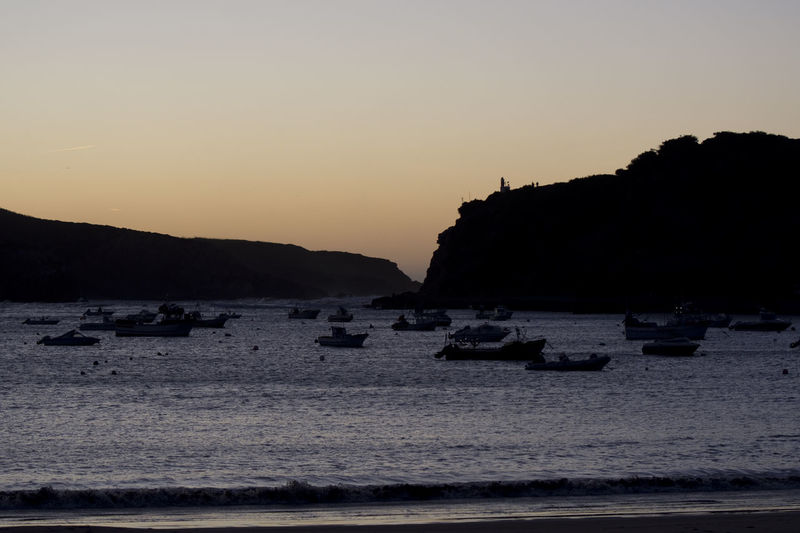 Sao Martinho do Porto, between Porto and Lisboa. Harbour View Portugal Beach Beauty In Nature Clear Sky Day Mountain Nature Nautical Vessel No People Ocean Outdoors Scenics Sea Silhouette Sky Sunset São Martinho Do Porto Tide Tide Coming In Tranquil Scene Tranquility Water Waterfront