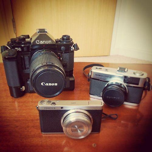 """The Collection"" 1979 Canon A1, 1973 Olympus Trip, 2014 Fuji XF1 Cameras 35mmfilm VintageCamera Olympustrip Olympus CanonA1 Canon Fujixf1 Fuji Cameracollection Photography Cameras"