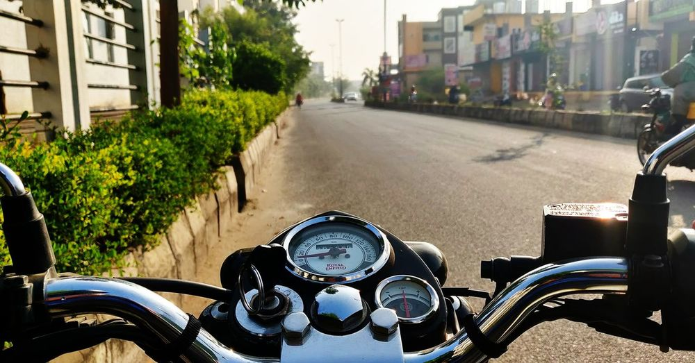 Close-up of motorcycle on road in city