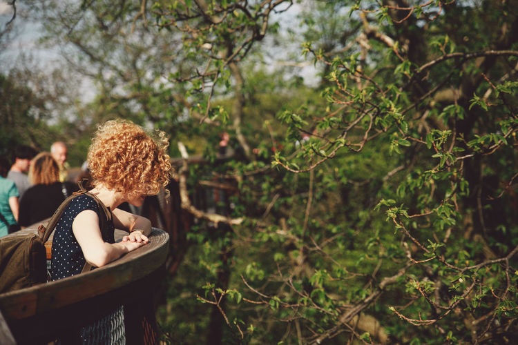 Beauty In Nature Blonde Close-up Curly Hair Day Focus On Foreground Girl Growth Leisure Activity Lifestyles Nature Nature Outdoors Park Plant Sping Tranquility Tree