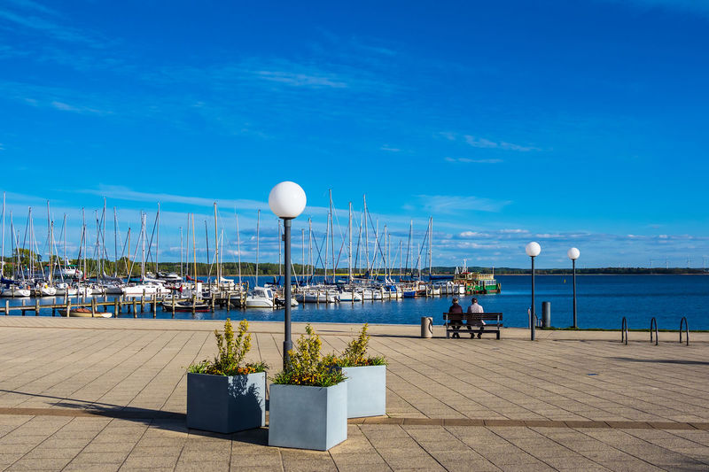 View to the port of Rerik, Germany. Water Sky Cloud - Sky Nature Sea Day Outdoors Rerik Salzhaff Mecklenburg-Vorpommern Baltic Sea Coast Shore City Town Architecture Travel Destinations Travel Tourism Vacation Relaxing Port Harbor Boat Ship Sailing Ship Sailboat Fishing Boat