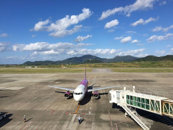 Airplane Airport Sky Mountain 新石垣空港 石垣島 Ishigaki Island Peach AirPlane ✈ Airportphotography Airport Airport Waiting Trip Photo Trip Beauty In Nature Cloud - Sky Blue Blue Sky