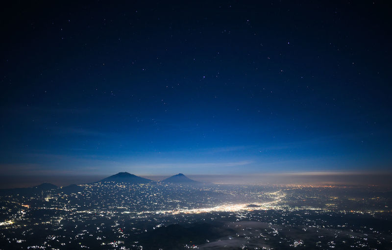 Mount Merbabu and Merapi Night Illuminated Building Exterior Sky Architecture Cityscape City Built Structure Nature Scenics - Nature Star - Space No People Building Mountain Beauty In Nature Outdoors Blue Glowing Astronomy Cityscape INDONESIA Photography Nikonphotography