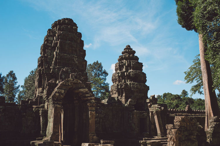Siem Reap Cambodia Angkor Ancient History Religion Old Ruin The Past Place Of Worship Sky Belief Spirituality Ancient Civilization Architecture Built Structure Travel Tourism Low Angle View Nature Travel Destinations Old No People Archaeology Ruined Outdoors Deterioration