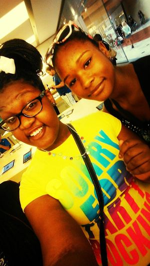 me and my lil sis in the apple store at the mall :D Hanging Out